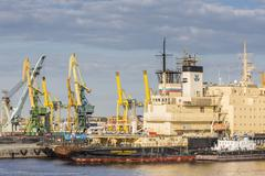 The busy shipyards in the Sea Port of St. Petersburg, on the Neva River, Russia Stock Photos