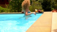 Stock Video Footage of Pretty Woman Relaxing in Swimming Pool with Juice and Fruits.