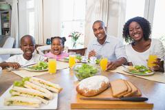Stock Photo of Happy family enjoying a healthy meal together