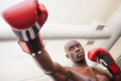 Male boxer attacking with his right in health club - stock photo