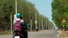 Vietnam Phú Mỹ district villages 051 street through caoutchouc forest Stock Footage