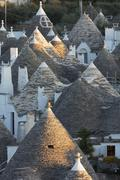 Rooftops of traditional trullos (trulli) in Alberobello, Puglia, Italy - stock photo