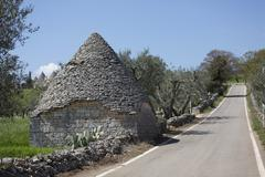 Traditional trullos (trulli) in the countryside near Alberobello, Puglia, Italy Stock Photos