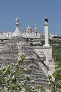Roof of traditional trullo with Locorotondo in distance, Puglia, Italy, Europe Stock Photos