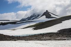 Snowfield below Mutnovsky volcano, Kamchatka, Russia, Eurasia - stock photo