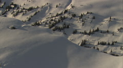 1080HD Cineflex British Columbia flying over snowy cliff Stock Footage
