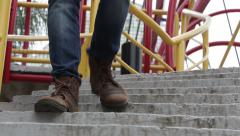 Boot down stairs Stock Footage