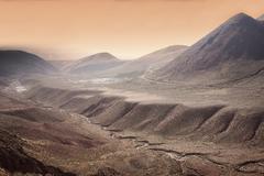 High altitude Atacama desert landscape near Tatio Geyser Field at sunset, Chile Stock Photos