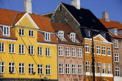 Old buildings in famous Nyhavn harbour area of Copenhagen, Denmark, Scandinavia - stock photo