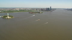 Flying above Statue of Liberty, New York City, USA Stock Footage