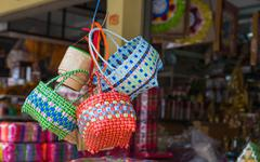 The colorful weave basket hang for sell at the grocery shop Stock Photos