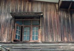 the window of the old wooden house - stock photo