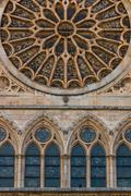 lancet arch windows under the main rose window of the cathedral of leon - stock photo