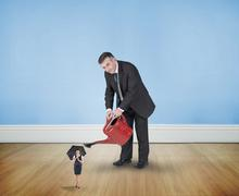 Composite image of mature businessman watering tiny businesswoman - stock illustration