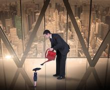 Composite image of businessman watering tiny business woman - stock illustration