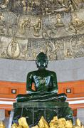 The green buddha made from jade in thailand Stock Photos