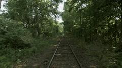 Fast forward along railway through woodland 4K Stock Footage