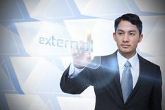 Businessman pointing to word external - stock illustration