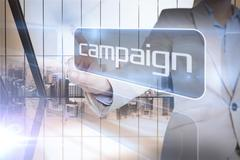 Stock Illustration of Businesswoman presenting the word campaign