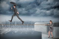 Young businesswoman pulling a tightrope for businessman - stock illustration