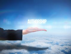 Stock Illustration of Businesswomans hand presenting the word authorship