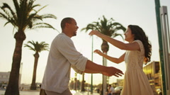 Happy romantic couple on vacation, outdoors in Italian city as sun begins to set - stock footage