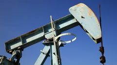 Oil Beam Pump (Sucker Rod or Pumpjack) in the Country Side. Stock Footage