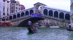 Couple in gondola at the grand rialto in venice Stock Footage