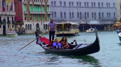 Couple in gondola on the grand canal in venice Stock Footage