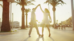 Happy romantic couple on vacation, dancing outdoors in Italian city - stock footage