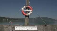 0156Norway lakeview lifebuoy sign Stock Footage
