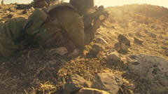 Armed soldiers walking through field. soldiers running with Machine gun weapons. Stock Footage
