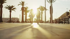 Romantic couple walking through the city as the sun begins to set - stock footage