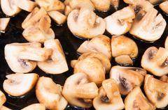 quartered roasted champignons - stock photo
