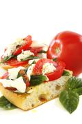 Sandwich with tomato, cheese and basil. Stock Photos