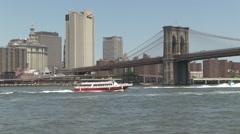 Pan ships under Brooklyn Bridge Stock Footage