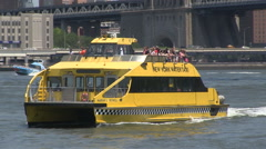 Water taxi past camera close NY - stock footage