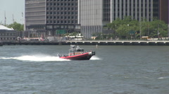 Inflatable fire dept boat new york manhattan Stock Footage