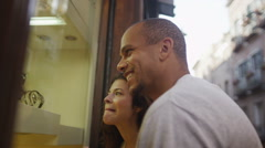 Happy attractive couple window shopping in Italian town - stock footage