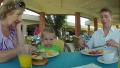 Family Eat Breakfast Food at Summer Resort Hotel. Time Lapse - stock footage