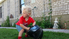 2 year old donning a motorcycle helmet-S4-HD_P Stock Footage