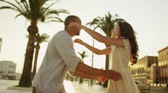 Happy couple on vacation, outdoors in Italian city as the sun begins to set - stock footage