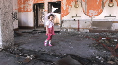 Abandoned little girl in ruined house,color Stock Footage