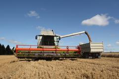 Machine harvesting the corn field Stock Photos