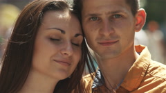 4K & HD resolutions: Nice lovers portrait video in the anonymous crowd stream Stock Footage
