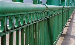 only railing in perspective on st. johns bridge - stock photo