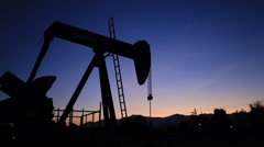 Silhouette Moving Oil Pumpjack (Sucker Rod Beam) at Sunset Time Stock Footage
