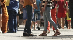 4K & HD resolutions: Lover's legs CU view in the crowd, romantic scene Stock Footage
