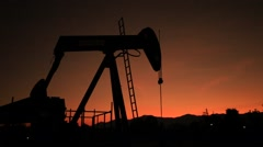 Silhouette Moving Oil Pumpjack (Sucker Rod Beam) at Sunset Time - stock footage