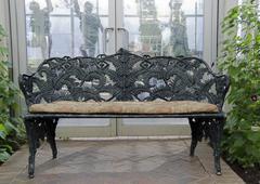 wrought iron bench - stock photo